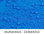 rain water droplets on blue... | Shutterstock . vector #223664212