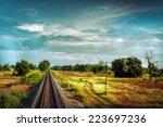 railway track crossing rural...   Shutterstock . vector #223697236