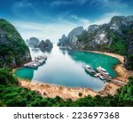 tourist junks floating among... | Shutterstock . vector #223697368