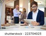 handsome businessman in casual...   Shutterstock . vector #223704025