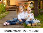 brother and sister in knitted... | Shutterstock . vector #223718902