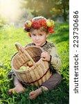 cute boy wearing a crown of... | Shutterstock . vector #223730686