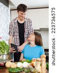 happy young couple cooking with ... | Shutterstock . vector #223736575