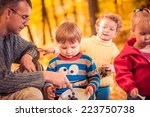 man with kids at fall forest | Shutterstock . vector #223750738