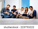 portrait of a smiling friends... | Shutterstock . vector #223753222
