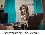 funny smiling skeleton sitting  ... | Shutterstock . vector #223799008