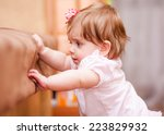 little girl stands near the... | Shutterstock . vector #223829932
