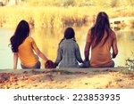 mother and father with young... | Shutterstock . vector #223853935