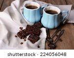 cups of coffee with chocolate... | Shutterstock . vector #224056048