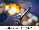 female using her mobile phone ... | Shutterstock . vector #224182255