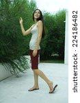 woman standing  touching bush ... | Shutterstock . vector #224186482