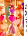 Small photo of Kitschy colorful heart ornaments as a symbol for love