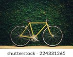 Yellow Bicycle On Leaf Wall...