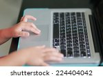 litter hand touch on touch pad...   Shutterstock . vector #224404042