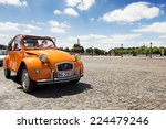 Постер, плакат: Old Citroen 2CV parked