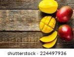 Mango On A Dark Wood Backgroun...
