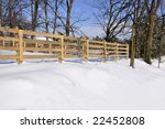 Wood Fence By A Field And Trees