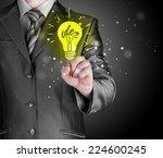 business man touching light of... | Shutterstock . vector #224600245
