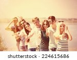 beautiful young people on beach | Shutterstock . vector #224615686