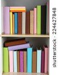 books on wooden shelves close up   Shutterstock . vector #224627848