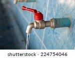 closeup water drop from faucet | Shutterstock . vector #224754046