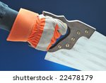 Construction Worker hand and arm with saw over blue gradient background - stock photo