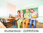 children sitting in row on desk ...   Shutterstock . vector #224905246