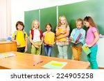 six children stand in row near... | Shutterstock . vector #224905258