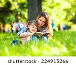 mother and daughter reading a... | Shutterstock . vector #224915266
