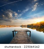 Pier On A Calm River In The...