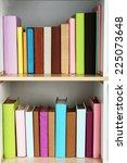 books on wooden shelves close up   Shutterstock . vector #225073648