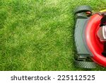 Red Lawn Mower Cutting Grass....