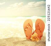 flip flops on sand beach   Shutterstock . vector #225121642