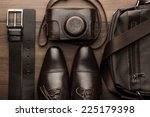 brown shoes  belt  bag and film ... | Shutterstock . vector #225179398