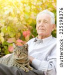 Senior Man Cuddle Tabby Cat In...
