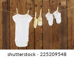 babywear and booties against... | Shutterstock . vector #225209548