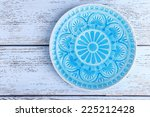 Plate On Color Wooden Background