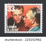 Small photo of UNITED STATES - CIRCA 1999: a postage stamp printed in USA showing an image of composers Alan Jay Lerner & Frederick Loewe , circa 1999.