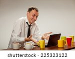 young man at a computer full of ... | Shutterstock . vector #225323122
