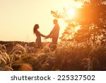 young couple holding hands at... | Shutterstock . vector #225327502