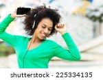 afro american woman listening... | Shutterstock . vector #225334135
