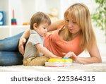mother and kid boy having fun...   Shutterstock . vector #225364315