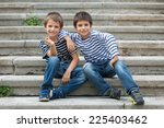 two brothers portrait having... | Shutterstock . vector #225403462