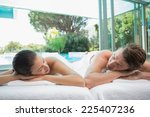 portrait of young couple lying... | Shutterstock . vector #225407236