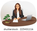 Businesswoman Is Sitting At Th...