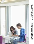 business colleagues using... | Shutterstock . vector #225460396