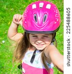 young girl riding bicycle... | Shutterstock . vector #225488605