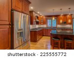 Stock photo corner newly finished kitchen with granite counter top hardwood cabinet and floor stainless steel 225555772