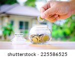 male hand putting money coins... | Shutterstock . vector #225586525