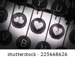 Small photo of Typewriter with special buttons, lovers - love - heartbroken